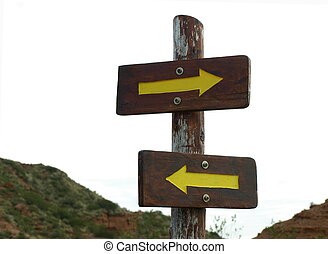 opposite directions - two arrows pointing in opposite...