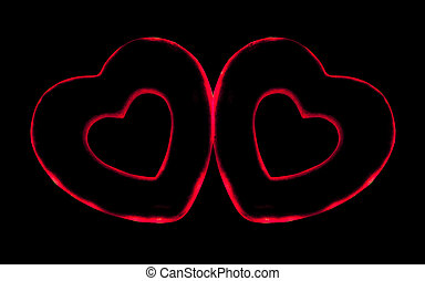 Two artificial red heart on a black background