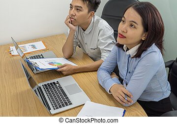 Two Asian business employee in the meeting room