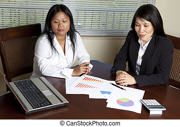 Two Asian Business Women