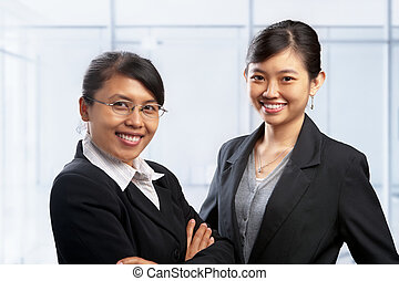 Two Asian businesswoman in office