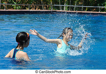 Two Asian kids playing in swimming pool