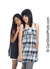 Two asians having a secret