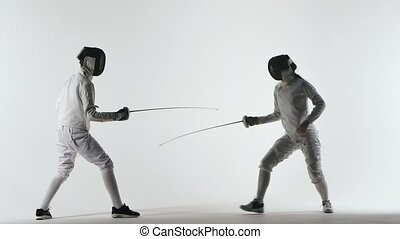 Two athlete wearing helmets and white uniforms show ...