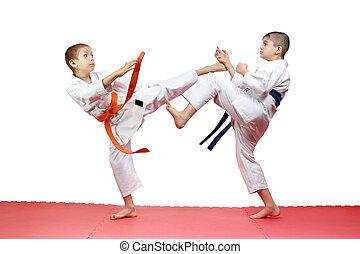 Two athletes are beating kicks