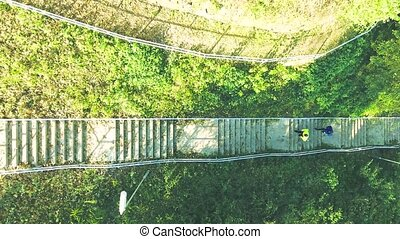 Two athletes running on stairs in sunny autumn nature. -...