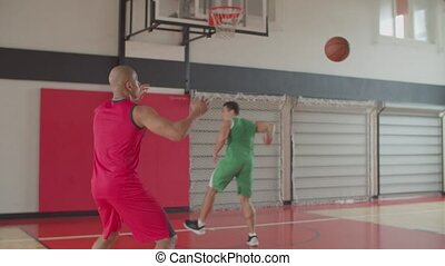 Two athletes training basketball skills indoors - Two ...