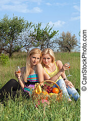 Two attractive blonde with wineglasses