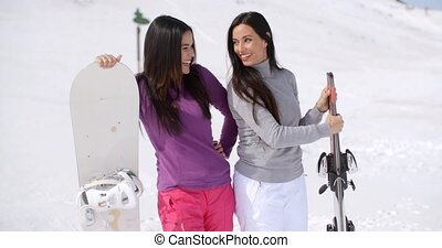 Two attractive female friends at a ski resort