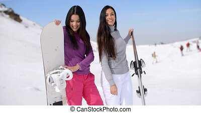 Two attractive female friends at a ski resort - Two...