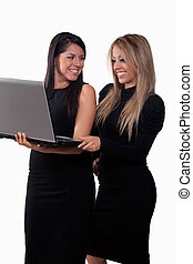 Two attractive hispanic twenties businesswomen talking