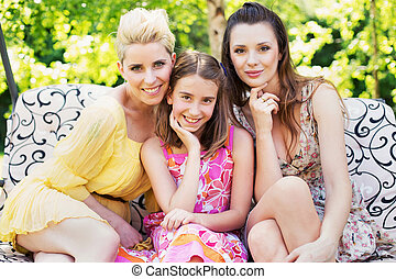 Two attractive ladies with young girl