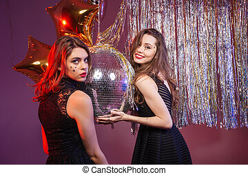 Two attractive smiling women having party