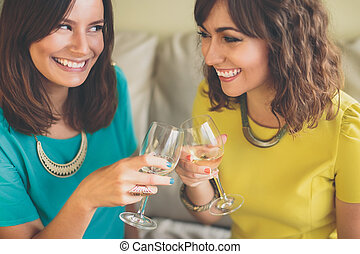 Two attractive woman toasting with champagne