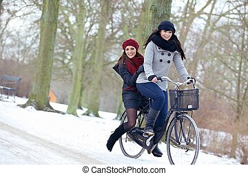 Two Attractive Women Enjoying the Cold Outdoors