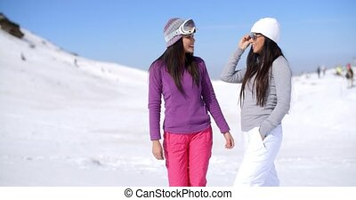 Two attractive women friends at a ski resort