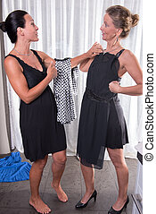 two attractive women - getting ready for the evening
