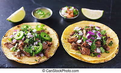 two authentic mexican tacos with barbacoa and carnitas