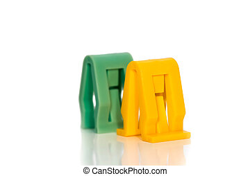 Two automotive plastic clips on white background