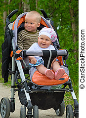 Two babies in children buggy - Two children in baby carriage...