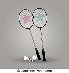 Two badminton rackets with shuttlecock on gray background.