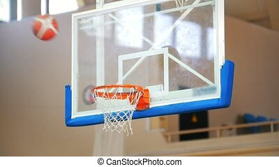 Two balls flying in the hoop, basketball, nice trowing.