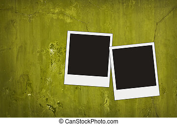 two balnk photos on olive vintage cracked concrete wall