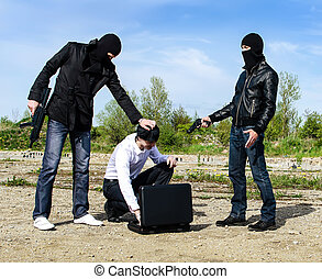 Two bandits kidnapped a businessman with a suitcase