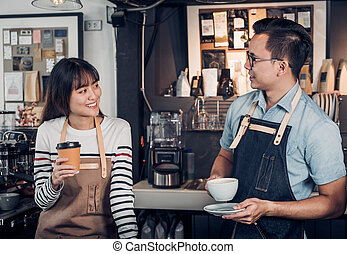 Two barista talking together about tasted of coffee cup with happy emotion at counter bar at cafe.coffee shop business owner concept,Service mind waiter.