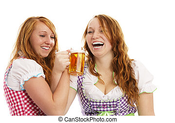 two bavarian girls cheering with beer on white background