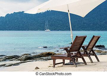 Two beach chairs on the beach