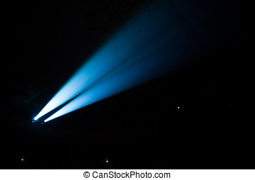 Two beams in dark concert hall. - Two beams of searchlights...