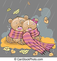 Two bears in a scarf sitting in the rain