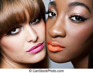 Two beauties with perfect skin