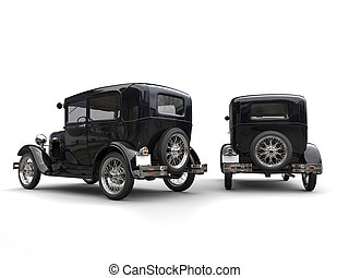 Two beautiful 1920s vintage cars - side by side - back view
