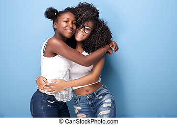 Two beautiful african american girls smiling