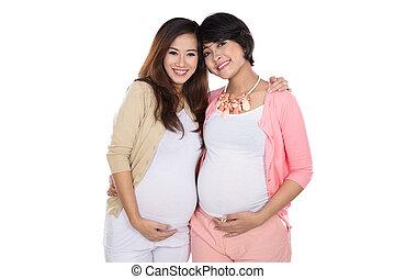 two beautiful asian pregnant women