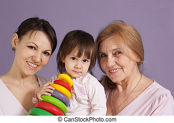 Two beautiful Caucasian woman with a little girl