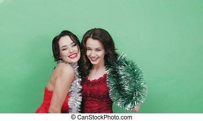 Two beautiful girl in the studio with Christmas decorations