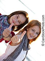 Two beautiful girl show OK