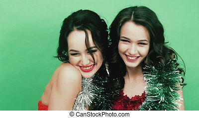 Two beautiful girl with artificial snow New Year