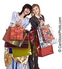Two beautiful girlfriends enjoy shopping.
