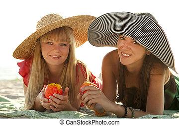 Two beautiful girls at beach
