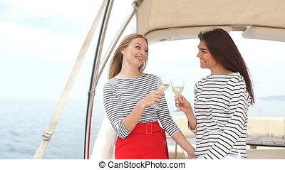 Two beautiful girls enjoying a trip on a boat in Black sea