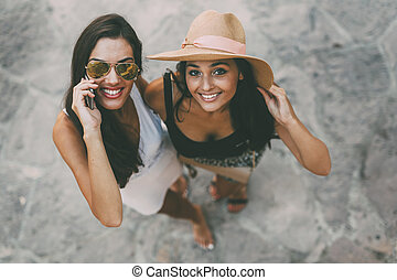Two beautiful girls in summer clothes