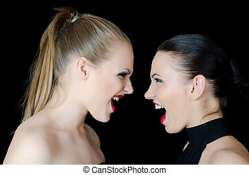 Two beautiful girls shout and swear - The two beautiful...