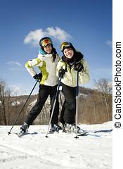 Two beautiful girls skiing