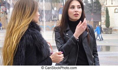 two beautiful girls speak Street - two young beautiful girls...