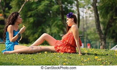 two beautiful girls talk