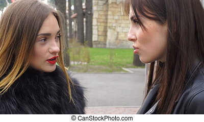 two beautiful girls talking in the Park